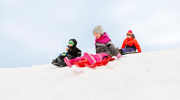 group children sledding