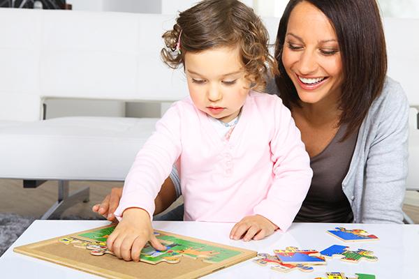 preschooler teacher solving puzzle
